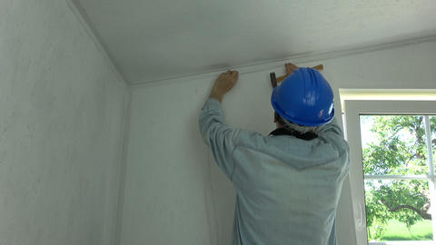 Worker fixing new electricity wire on wall Footage