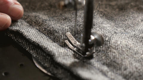 Sewing clothes on an old sewing machine. Close-up of needle and thread. Slow Live Action