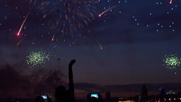 A group of people shoot fireworks using smartphones ビデオ