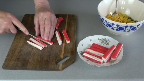 Cutting crab sticks on cutting board Live Action