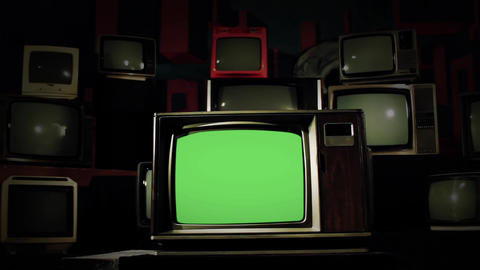 80 s Tv Green Screen in the Middle of Many Tvs. Cold Tone Live Action