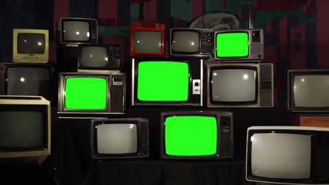 80s Televisions With Green Screens That Turn On. Gold Tobacco Tone Footage