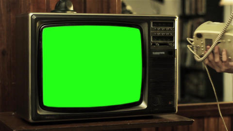 Teenage Boy Talking On Old Phone Near Television With Green Screen Live Action