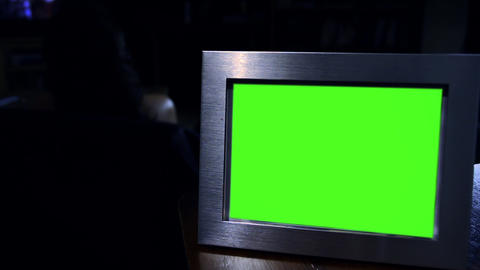 Photo Frame With Green Screen In The Dark. Zoom In Archivo