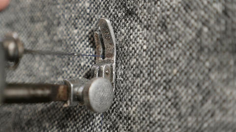 Needle and thread in a sewing machine. Sewing of clothes. Slow motion. Close-up Live Action