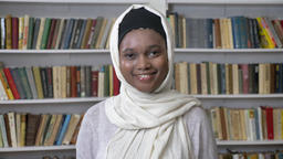 Young charming african muslim girl in hijab is watching at camera, religioun Footage