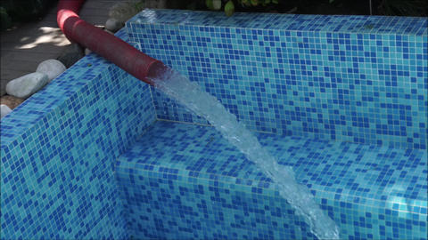 Filling the swimming pool with water in the beginning of summer Footage