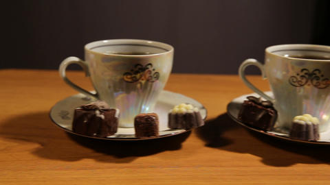 Tea set on the table with chocolate candy Live Action