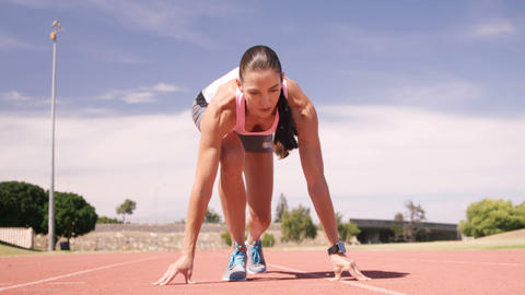 Focused sportswoman running Footage