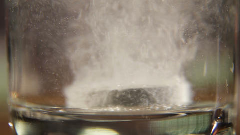 Effervescent tablet falling in water Footage