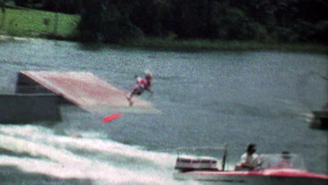 1967: Acrobatic stunt waterskier flips off ramp and safely lands Footage