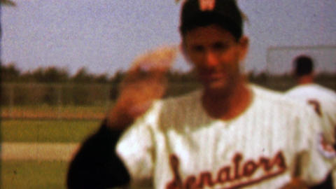 1960: Washington Senators baseball player tips hat to fan photographer Footage