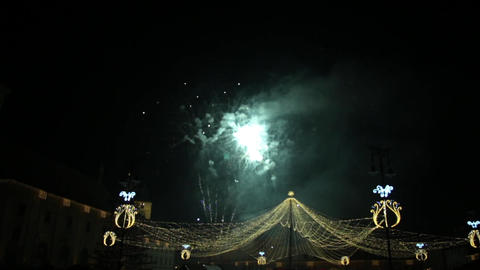 Colorful fireworks in the sky black night above the central square of the city a Footage