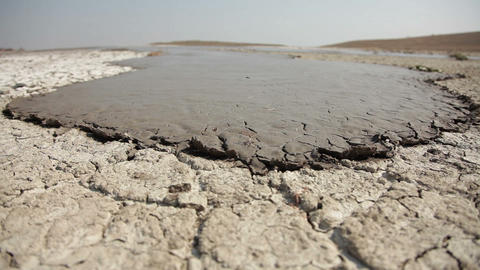 Dried and Cracked Lava of a Mud Volcano Live Action