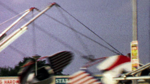 1967: Amusement park ride in shopping strip mall parking lot Footage