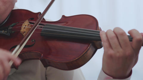 Violin musical instrument violinist hand. Classical musician orchestra music Footage