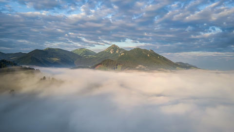 Epic fly above clouds in morning mountains Time lapse Archivo