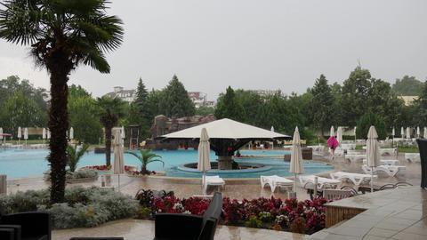 Heavy rain in swimming pool complex GIF