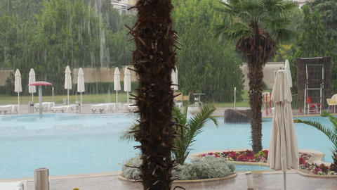 Raining on aqua park complex - bad weather in summer GIF