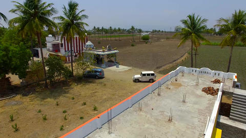 Aerial tracking shot of upcoming car and park in outdoor parking in India Live Action