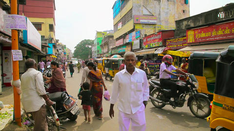 A busy and candid street scene in a market district of Chennai, India Footage