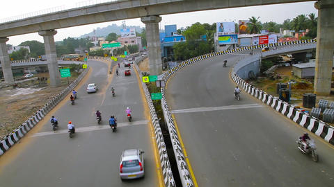 Timelapse shot on Motorbikes and Bus crossing a under the bridge, Busy rush hour Footage