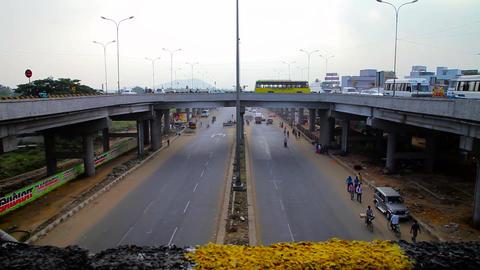 Motorbikes and Bus Passing Over Bridge. pedestrians passing under the bridge on Footage