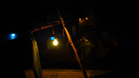 Light Bulb in the house. Village house in India at night with light bulb Live Action