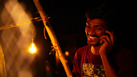 Young cheerful man talking on phone and smiling. Young man lost signal while Live Action