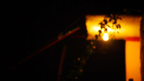 Light Bulb with Shifting Focus, Exterior shot of house at nighttime Footage