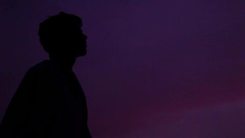 Silhouette of man standing in outside during sunset Live Action
