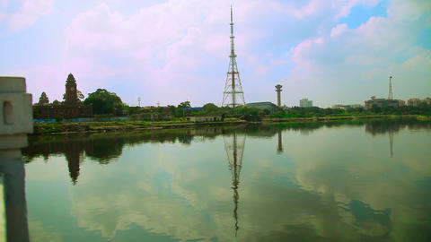 Beautiful nature water pond with blue sky, Cellphone telecommunication tower Live Action