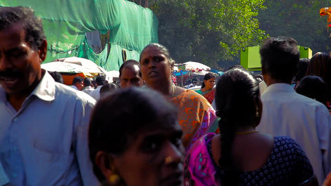 Crowds of people visit a popular shopping street in India Live Action