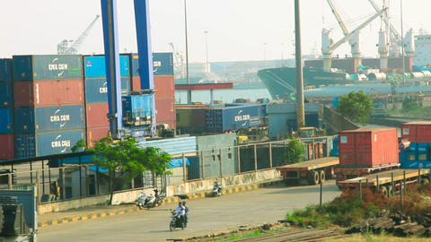 A truck ferries a shipping container at a port in the southern Indian city of Live Action