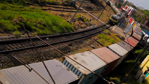 Top view container freight train with many cargo wagons transporting Live Action
