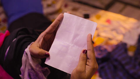 Woman hands holding and reading blank paper sheet or letter Footage