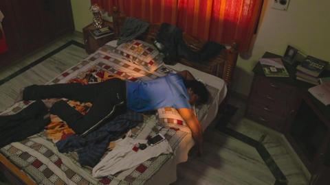 Young man deep sleeping in bed Footage