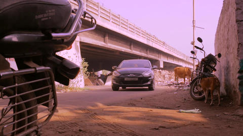 Camera low angle shot black car comes towards camera and entry on right side Live Action