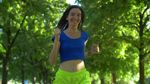 Female runner jogging during outdoor workout in park Footage