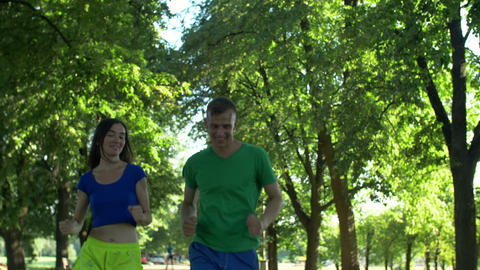 Runner man flirting with woman during jogging Footage