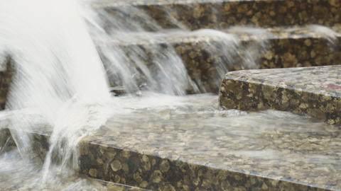 Stream of water from the fountain on the granite Footage