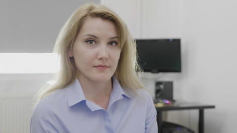 Pleased and assertive corporate young woman in the office accepting offer Footage