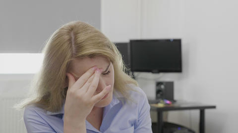 Depressed young corporate employee suffering from headache feeling upset and Live Action