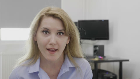 Young blonde office woman at work saying omg oh my God reaction with astonished Live Action