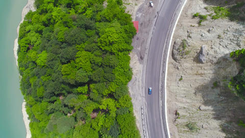 Aerial View Car on the Lake and Forest Road Live Action