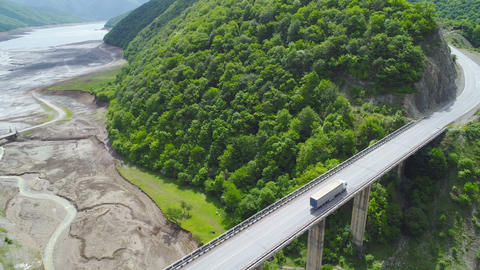 Aerial View Lorries are Moving on the Bridge in the Beautiful Nature Live Action
