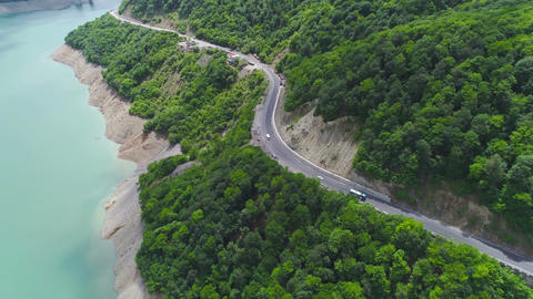 Aerial View of Cars Driving Through the Forest and the Lake Footage
