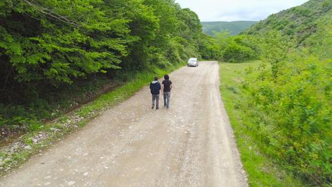 Two Men Walking In Forest Footage