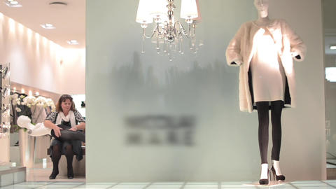 Saleswoman who dress up a model that will put him in the shop window clothing 37 Footage
