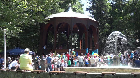 Show with clowns and princesses held in the city park in the presence of many ch Footage